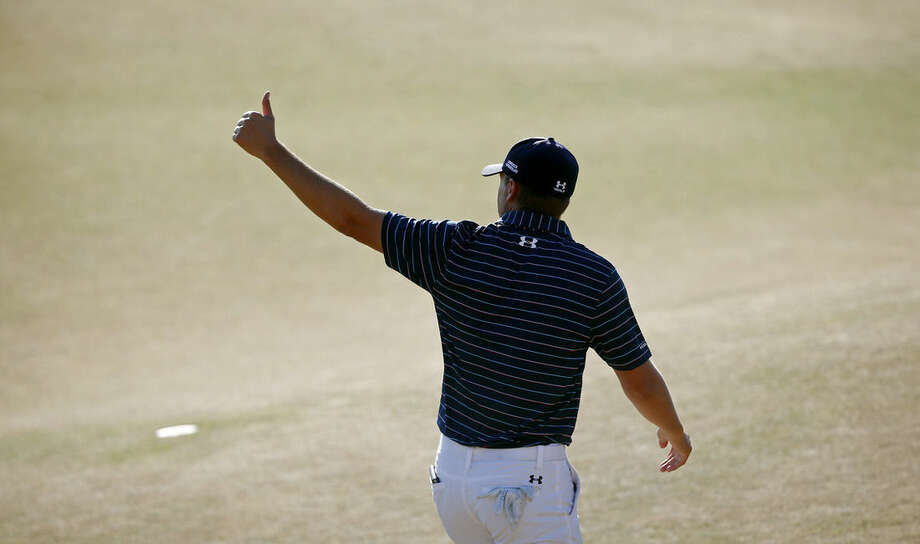 Jordan Spieth walks off the green after the final round of the U.S. Open golf tournament at Chambers Bay on Sunday, June 21, 2015 in University Place, Wash. Spieth won the championship. (AP Photo/Lenny Ignelzi)