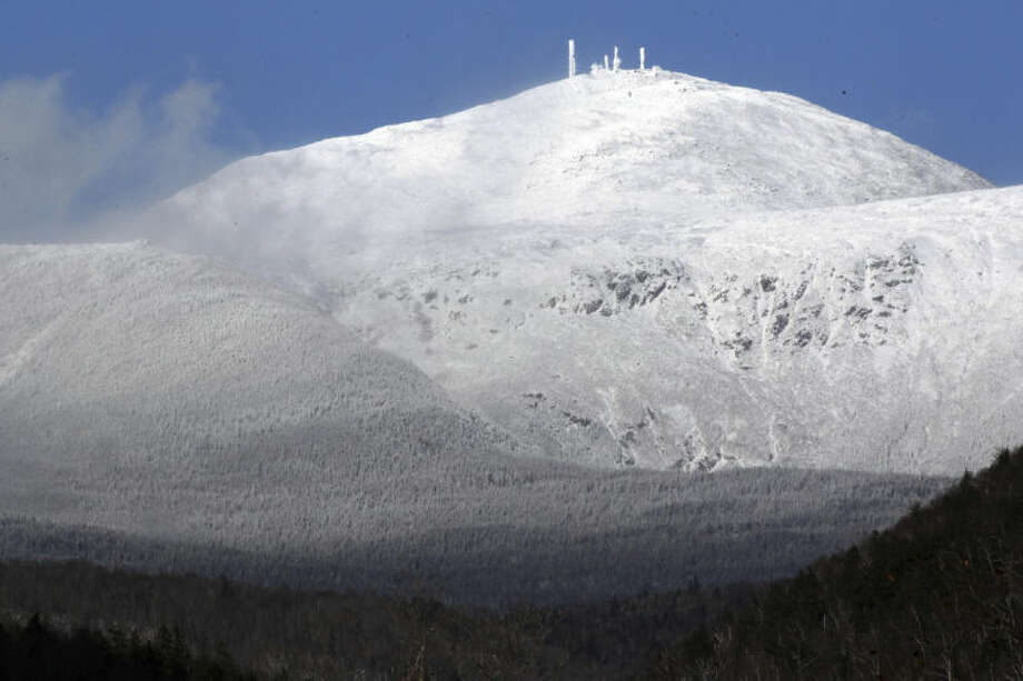 FILE - Mount Washington is covered in snow in this Wednesday, Nov. 13, 2013 file photo taken from Bartlett, N.H. Extreme Mount Washington sits on the top of the Northeast's highest peak, in New Hampshire. The museum recently underwent a $1 million transformation from a modest collection of artifacts behind glass to a modern facility packed with hands-on exhibits. (AP Photo/Jim Cole, File)
