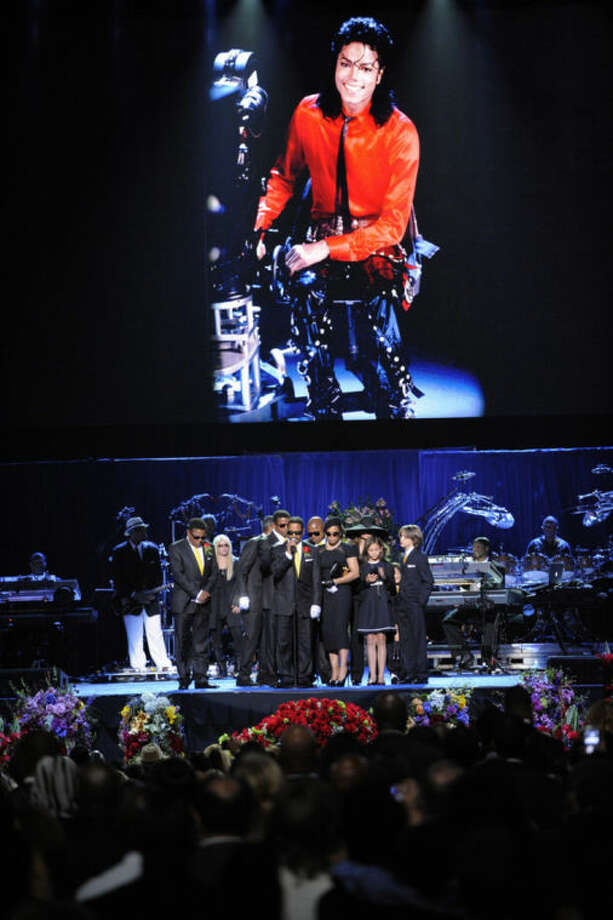 FILE - In this July 7, 2009 file photo, Marlon Jackson speaks on stage with the Jackson family during the memorial service for Michael Jackson at the Staples Center in Los Angeles. Five years after Jackson's untimely death at age 50, the singer remains a pop culture powerhouse, proving to be just as big a moneymaker in death as in life. He's graced the stage at the Billboard Music Awards via hologram, appears on a new album of unreleased songs and is generating tens of millions of dollars a year - money that will continue to grow and keep Jackson's mother and children living like entertainment royalty. Yet Jackson's tangled finances and debts have kept his family from being the biggest beneficiaries of his estate so far. (AP Photo/Mark J. Terrill, Pool, file)