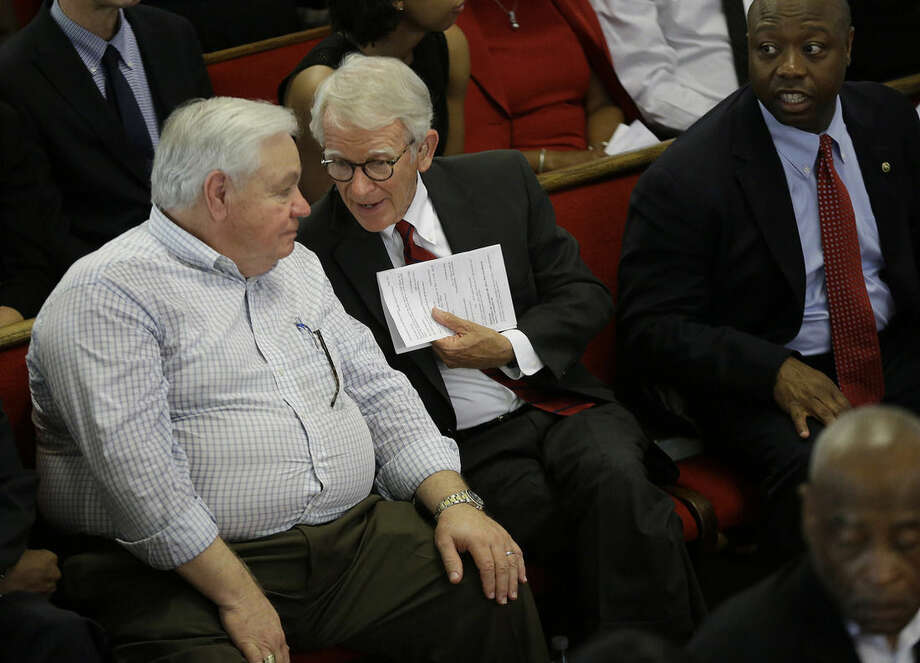 North Charleston Mayor R. Keith Summey, left, and Charleston Mayor Joseph P. Riley, Jr. talk at the Emanuel A.M.E. Church four days after a mass shooting that claimed the lives of it's pastor and eight others on Sunday, June 21, 2015, in Charleston, S.C. (AP Photo/David Goldman, Pool)