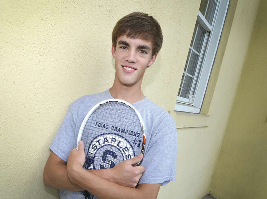 Hour Photo/Alex von KleydorffLuke Foreman came to tennis because concussions kept him from playing contact sports. Now he's one of the best players on one of the state's best teams.