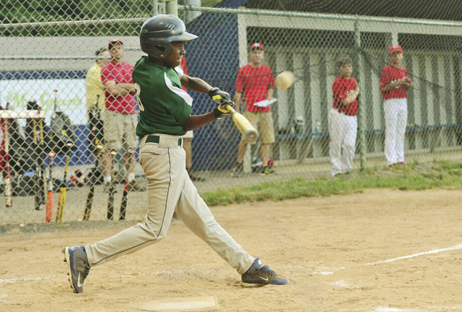 Hour photo/Erik TrautmannSignature Landscaping's Cameron Hurd hits an RBI against Stamford National's Knights of Columbus in the District 1 Little League's Tournament of Champions title game in Wilton on Saturday.