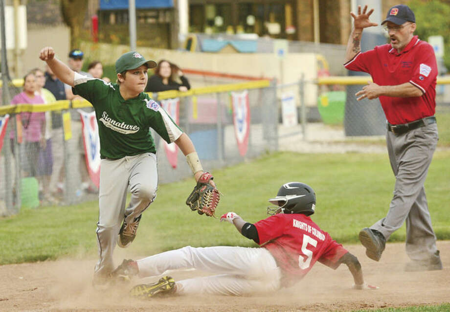 Hour photo/Erik TrautmannSignature Landscaping's Cooper Grillo tags out Knights of Columbus baserunner Isiah Johnson at third as they play in the Distict 1 Little League Tournament of Champions title game in Wilton Saturday.
