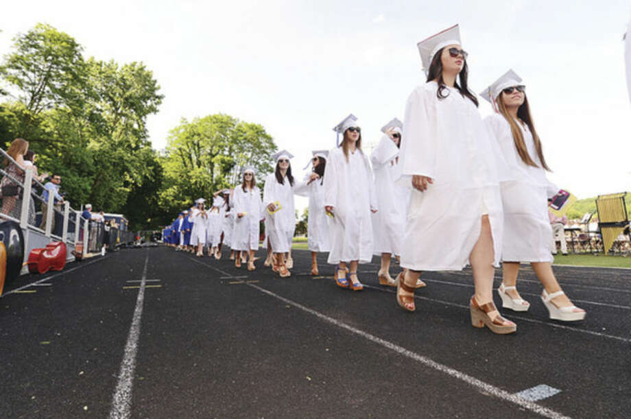 Hour photo / Erik Trautmann Wilton High School seniors proceed to the Class of 2014 commencement exercises Saturday.