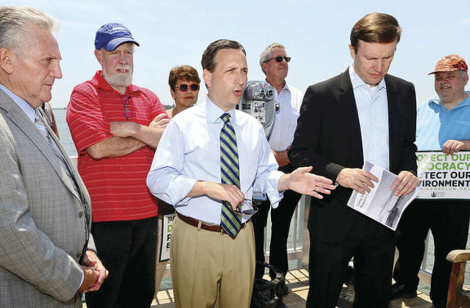 Hour photo / Erik Trautmann Satet Senator Bob Duff speaks as U.S. Senator Chris Murphy stopped at Calf Pasture Beach fishing pier Tuesday as part of a listening tour to discuss ways to preserve Long Island Sound. Senator was joined by environmental and business advocates urging the passage of legislation protecting the Sound.