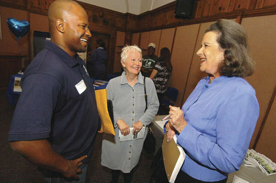 Hour photo/ Alex von Kleydorff From the left, Councilman Travis Simms talks with Eva Clements, assistant director of the Learning Center and Dr. Susan Weinberg, president of Mentor Consulting Group at the Norwalk Mentor Challenge at City Hall.
