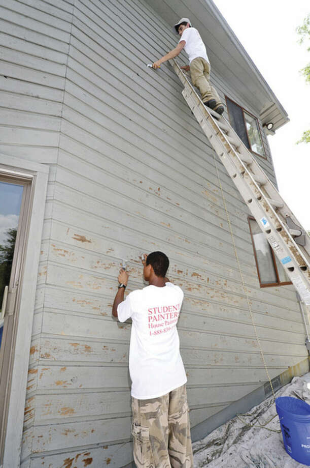 Hour photo / Erik Trautmann College students work for former Norwalk High School student William Hessert runs a crew for Student Painters, an exterior house painting company sponsored by Sherwin Williams that trains young entrepreneurs and gives them real world experience.