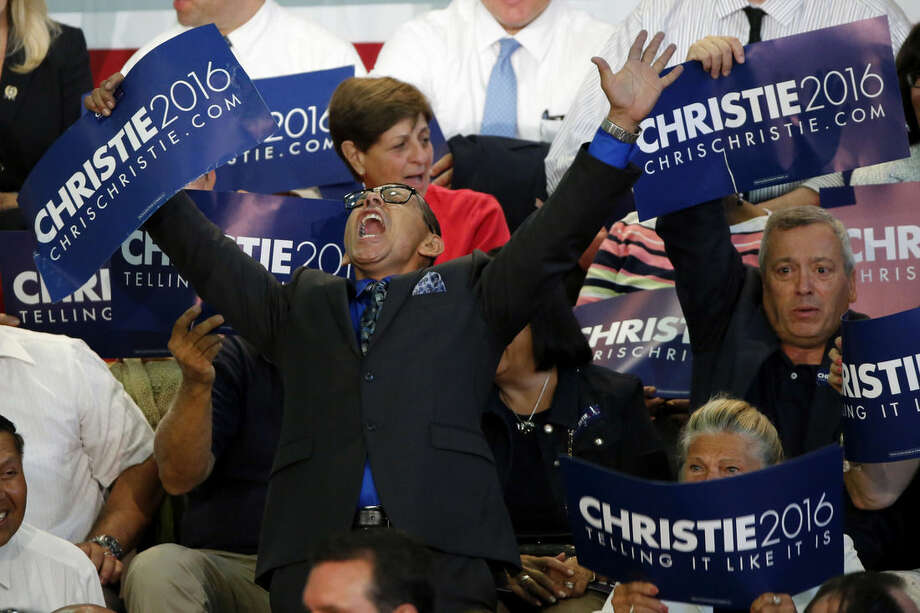 Angel Cordero, an activist from East Camden, N.J., shouts prior to an event in which New Jersey Gov. Chris Christie is expected to announce he will seek the Republican nomination for president, Tuesday, June 30, 2015, at Livingston High School in Livingston, N.J. (AP Photo/Julio Cortez)