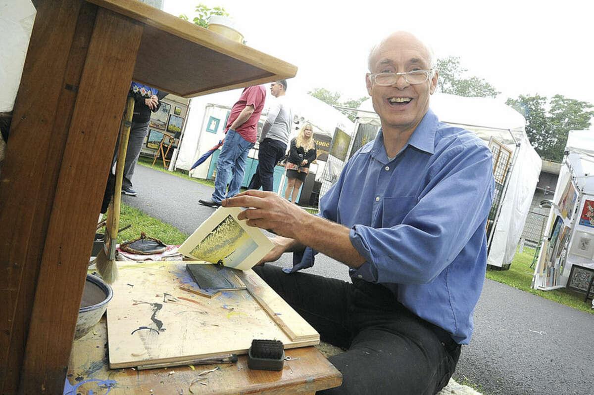 Artist Matt Brown making woodblock prints Sunday at the Norwalk Arts Festival held on the grounds at Mathews Park. Hour photo/Matthew Vinci