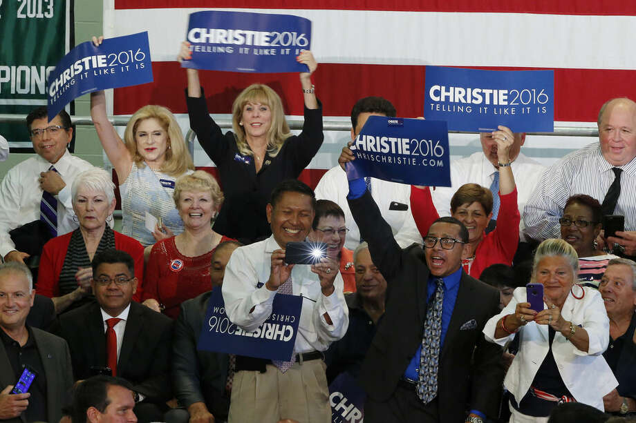 Supporters hold signs before the start of an event where New Jersey Gov. Chris Christie is expected to announce he will seek the Republican nomination for president, Tuesday, June 30, 2015, at Livingston High School in Livingston, N.J. (AP Photo/Julio Cortez)