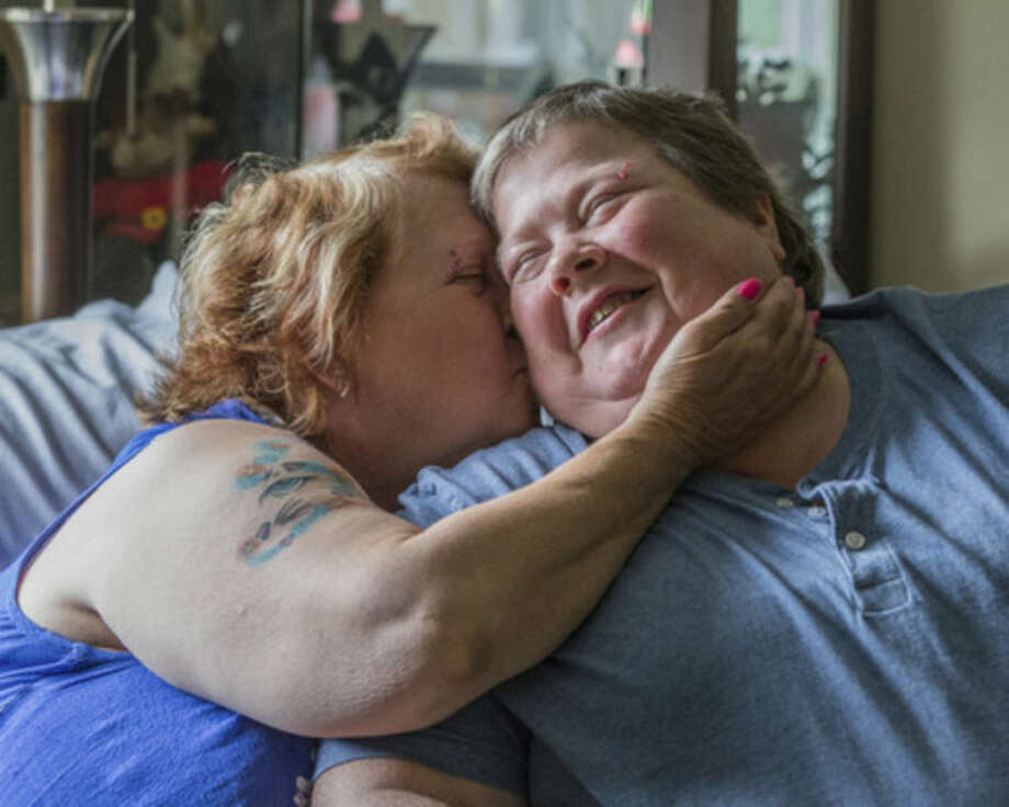 Lyn Judkins (left) kisses her partner or 13 years, Bonnie Everly reflecting on what today's court decision means to them in Chesterton on June 25, 2014. (AP Photo/Sun-Times Media, Jim Karczewski) MANDATORY CREDIT, MAGS OUT, NO SALES