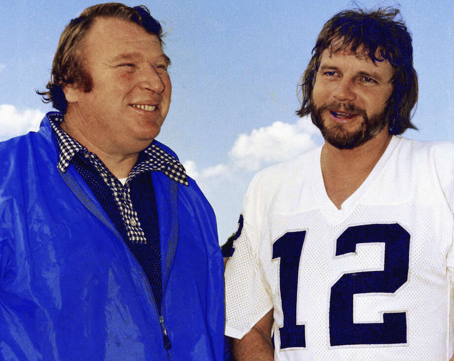 FILE - In this Jan. 4, 1977, file photo, Oakland Raiders quarterback Ken Stabler, right, talks with coach John Madden in Oakland, Calif. Stabler, who led the Raiders to a Super Bowl victory and was the NFL's Most Valuable Player in 1974, has died as a result of complications from colon cancer. He was 69. His family announced his death on Stabler's Facebook page on Thursday, July 9, 2015. (AP Photo/George Brich, File)