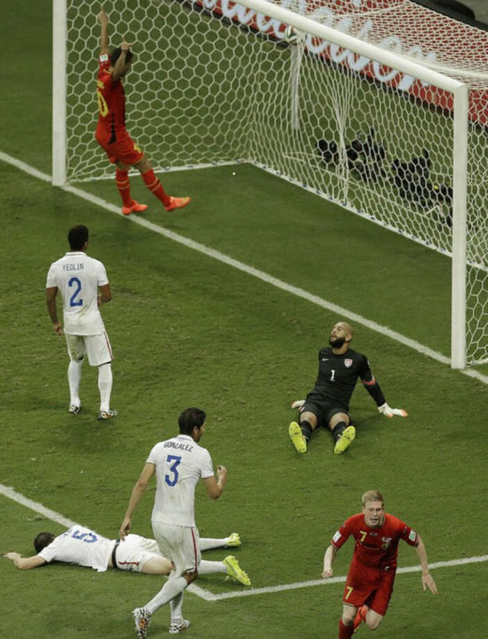 Belgium's Kevin De Bruyne, front right, celebrates scoring the opening goal during the World Cup round of 16 soccer match between Belgium and the USA at the Arena Fonte Nova in Salvador, Brazil, Tuesday, July 1, 2014. (AP Photo/Themba Hadebe)