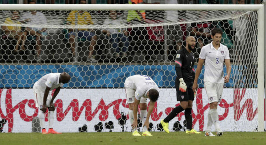 USA players react after Belgium's Romelu Lukaku scored his side's second goal in extra time during the World Cup round of 16 soccer match between Belgium and the USA at the Arena Fonte Nova in Salvador, Brazil, Tuesday, July 1, 2014. (AP Photo/Marcio Jose Sanchez)