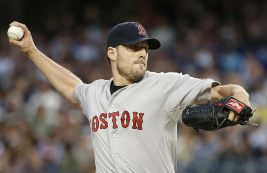 Boston Red Sox starting pitcher John Lackey delivers in the first inning of a baseball game against the New York Yankees at Yankee Stadium in New York, Sunday, June 29, 2014. (AP Photo/Kathy Willens)