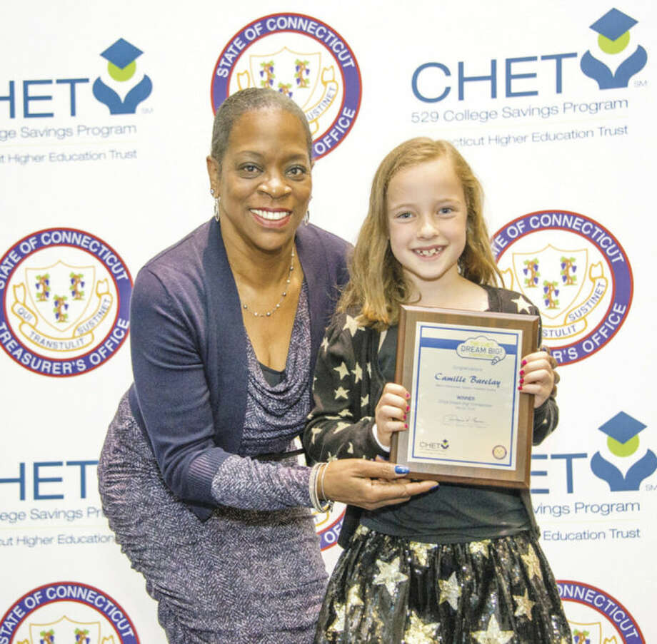 Contributed photo 2nd grader Camille Barclay of Marvin Elementary School received a plaque from State Treasurer Denise Nappier as part of the CHET Dream Big! Competition.