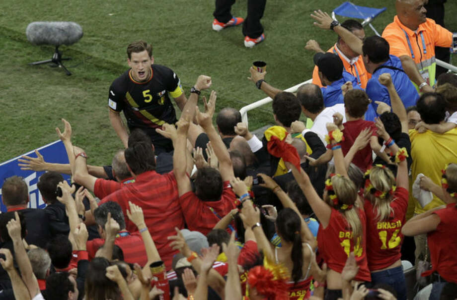 Belgium's Jan Vertonghen (5) gets congratulated by fans after he scored during the group H World Cup soccer match between South Korea and Belgium at the Itaquerao Stadium in Sao Paulo, Brazil, Thursday, June 26, 2014. (AP Photo/Andrew Medichini)