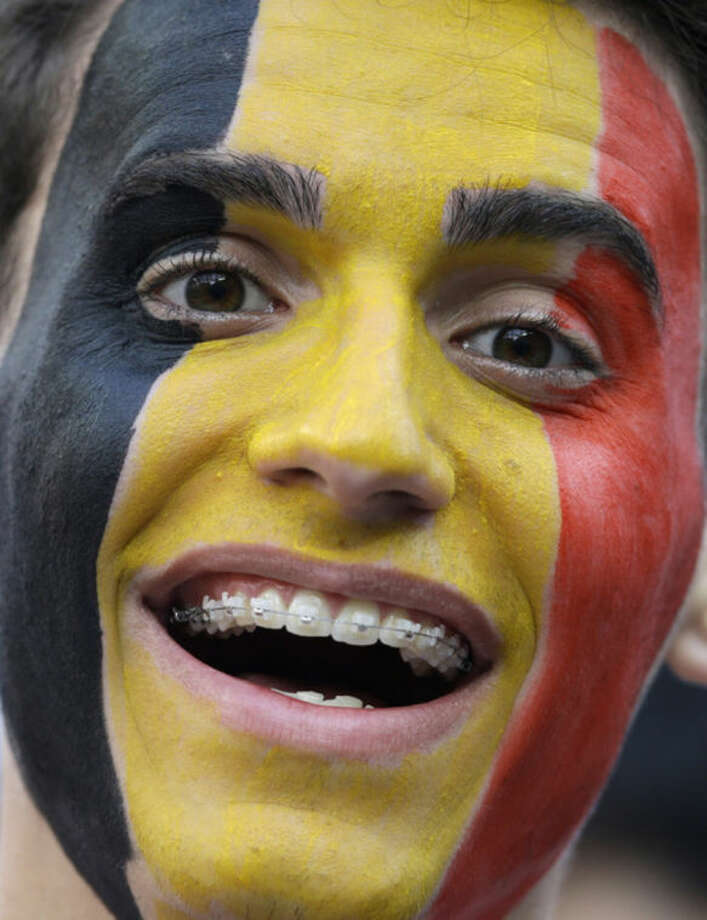 A Belgian fan shows off his face paint before the group H World Cup soccer match between South Korea and Belgium at the Itaquerao Stadium in Sao Paulo, Brazil, Thursday, June 26, 2014. (AP Photo/Thanassis Stavrakis)