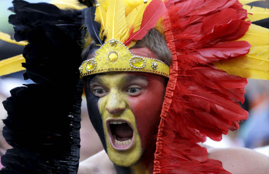 A Belgian fan cheers for his national team before the group H World Cup soccer match between South Korea and Belgium at the Itaquerao Stadium in Sao Paulo, Brazil, Thursday, June 26, 2014. (AP Photo/Thanassis Stavrakis)