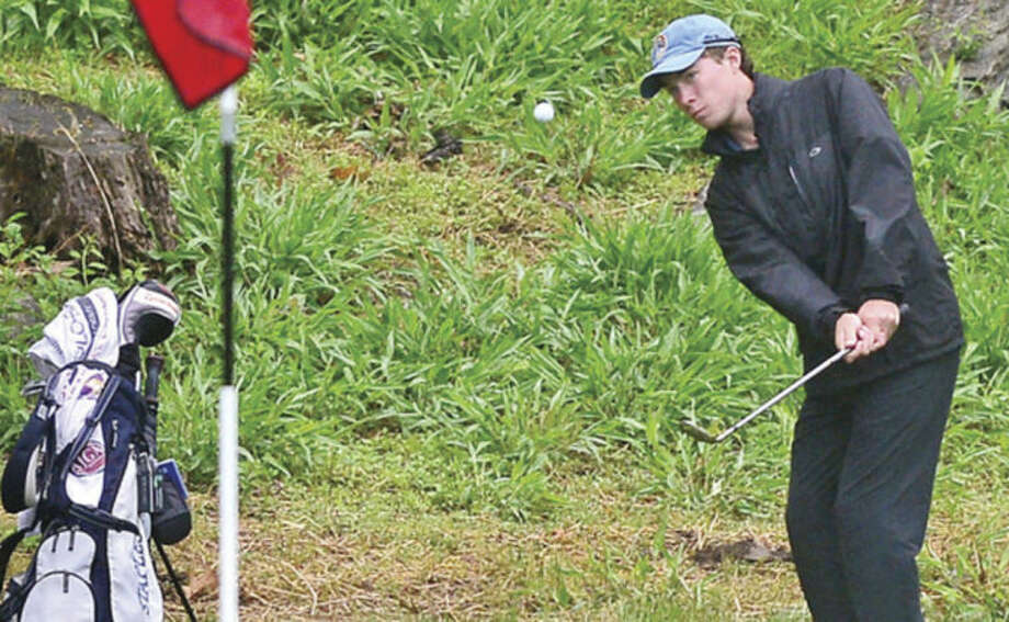 Hour photo/Erik TrautmannStaples' Peter Richards, seen here chipping on to the second hole during during the Chappa Golf Tournament at Longshore Park in Westport earlier this year, is The Hour's All-Area MVP for boys golf.