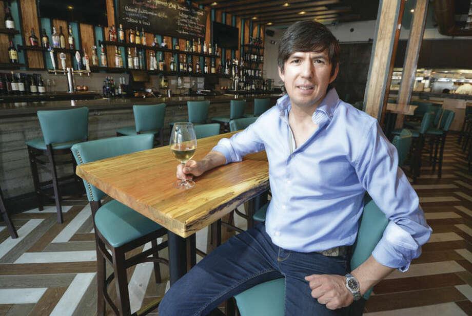 Hour photo/Alex von KleydorffCo-owner Alejandro Lopez inside Gastro Bar in downtown Stamford. Below, another look inside Gastro Bar.