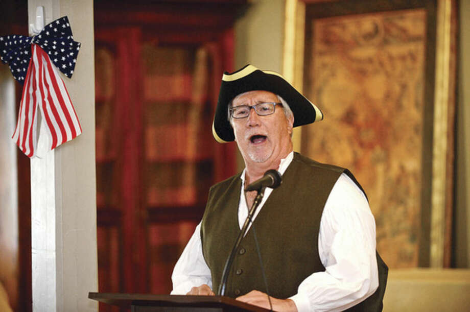 """Hour photos/Erik TrautmannTown Clerk Rick McQuaid reads excerpts from the Declaration of Independence during the Norwalk Historical Society's Independence Day """"Let Freedom Ring"""" National Bell Ringing Ceremony Saturday at the Mill Hill Historic Complex."""