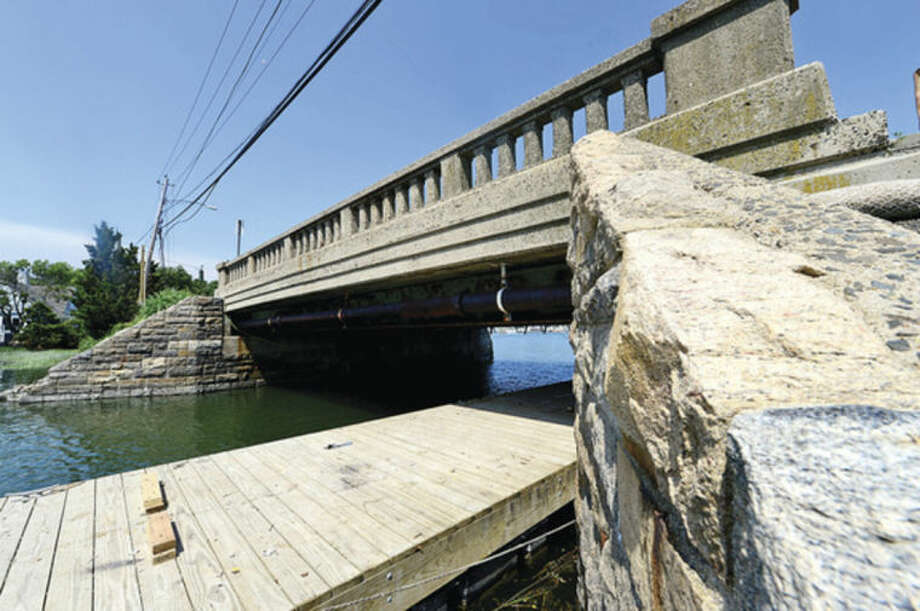Hour photo / Erik Trautmann Construction continues on the Bell Island Bridge on Bluff Ave. in Rowayton. The Norwalk Director of Public Works Hall Alvord close the bridge if kids will not refrain from jumping off it into Farm Creek. Alvord says activity is disrupting ongoing reconstruction of bridge and exposing city to liability.