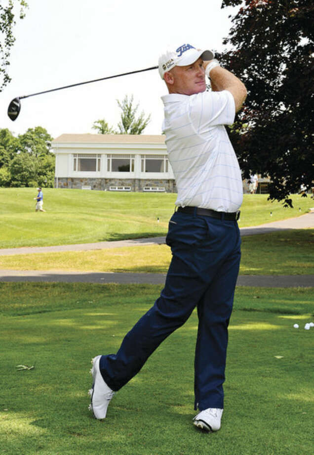 Hour photo / Erik TrautmannFormer Norwalk resident and golf pro Frank Bensel tees off at Rolling Hills Country Club following a press conference announcing the Connecticut Open Golf Championship at the club Wednesday.