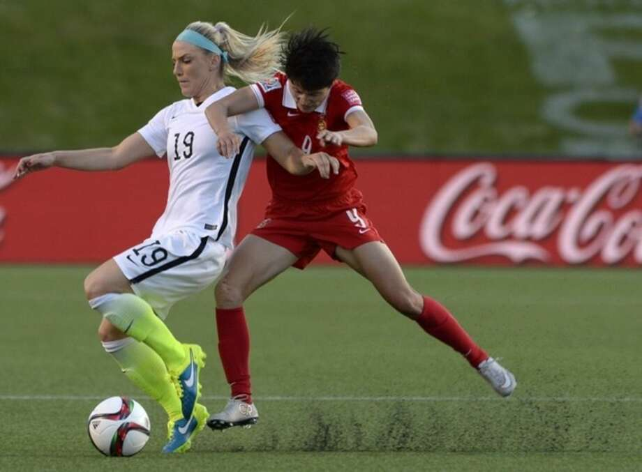 United States' Julie Johnston (19) battles China's Wang Shanshan (9) for the ball during the first half of a quarterfinal match in the FIFA Women's World Cup soccer tournament, Friday, June 26, 2015, in Ottawa, Ontario, Canada. (Adrian WyldThe Canadian Press via AP)