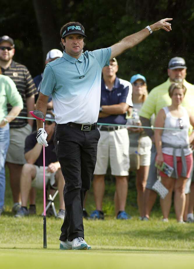 Bubba Watson points to the gallery that his ball is going left after his tee shot on the 13th hole during the second round of the Travelers Championship golf tournament, Friday, June 26, 2015, in Cromwell, Conn. (AP Photo/Stew Milne)