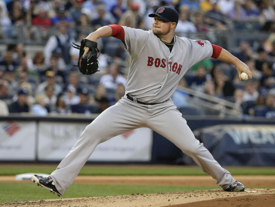 Boston Red Sox pitcher Jon Lester delivers against the New York Yankees in the second inning of a baseball game, Saturday, June 28, 2014, in New York. (AP Photo/Julie Jacobson)