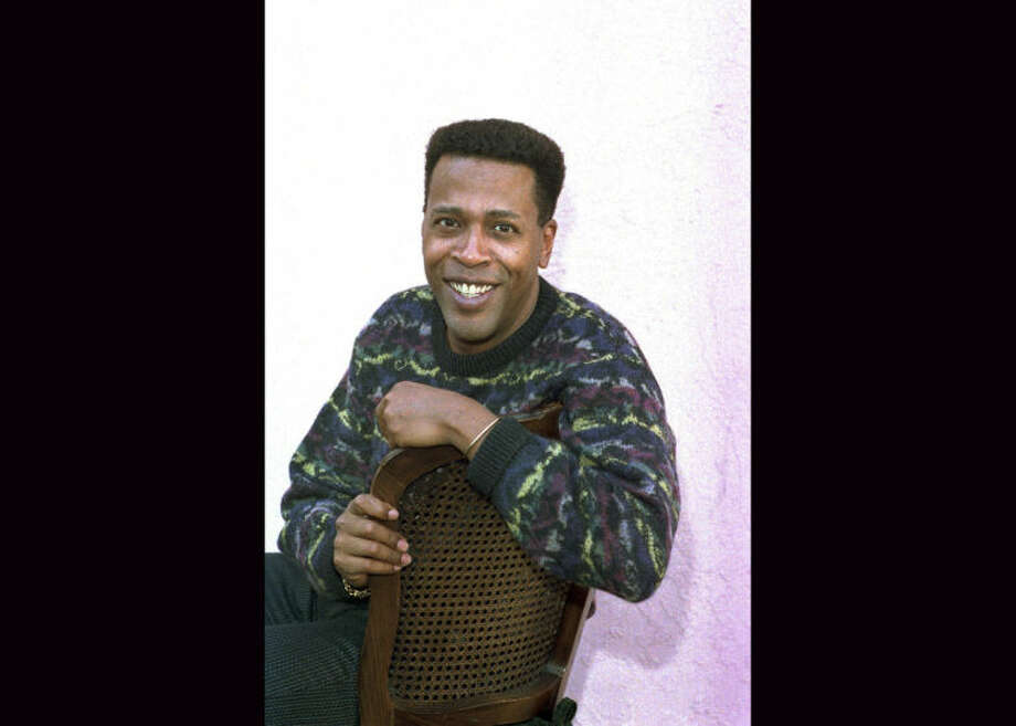 """FILE - In this Jan. 30, 1989 file photo, actor Meshach Taylor poses during an interview in Los Angeles, Calif. Taylor's agent says the actor, who appeared in the hit sitcoms """"Designing Women"""" and """"Dave's World"""" died of cancer on Saturday, June 28, 2014, at his home in Los Angeles. He was 67. (AP Photo/Nick Ut, File)"""