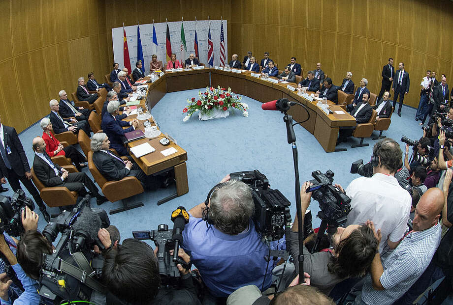 Overview of a last plenary session of the talks on the Iranian nuclear program that is being held at the United Nations building in Vienna, Austria, Tuesday, July 14, 2015. After 18 days of intense and often fractious negotiation, diplomats Tuesday declared that world powers and Iran had struck a landmark deal to curb Iran's nuclear program in exchange for billions of dollars in relief from international sanctions, an agreement designed to avert the threat of a nuclear-armed Iran and another U.S. military intervention in the Muslim world. (Joe Klamar/Pool Photo via AP)