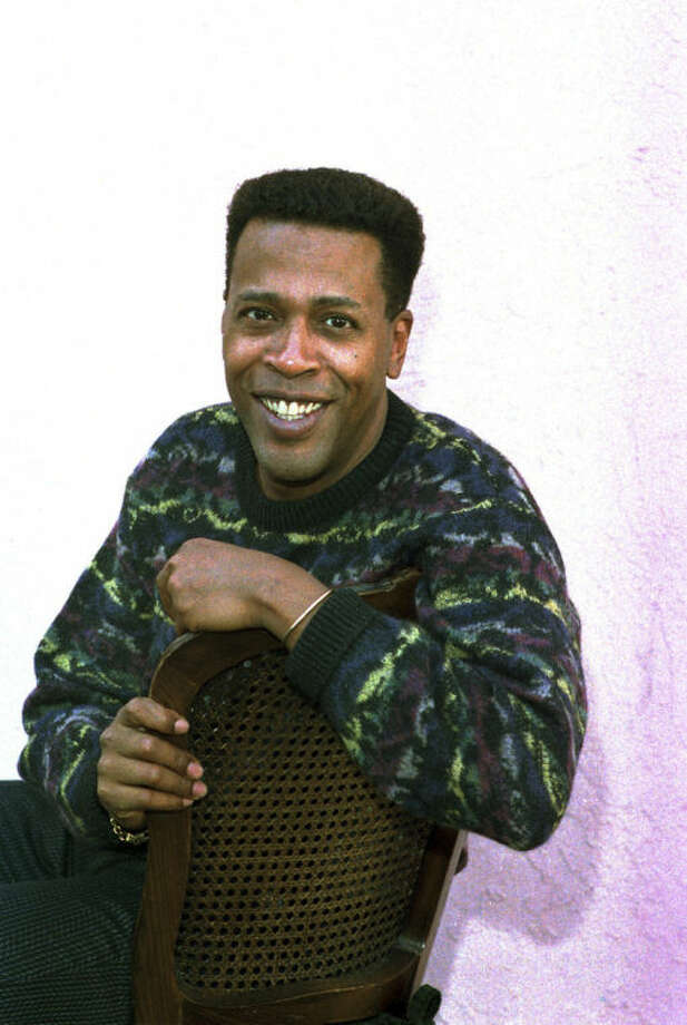 "FILE - In this Jan. 30, 1989 file photo, actor Meshach Taylor poses during an interview in Los Angeles, Calif. Taylor's agent says the actor, who appeared in the hit sitcoms ""Designing Women"" and ""Dave's World"" died of cancer on Saturday, June 28, 2014, at his home in Los Angeles. He was 67. (AP Photo/Nick Ut, File)"