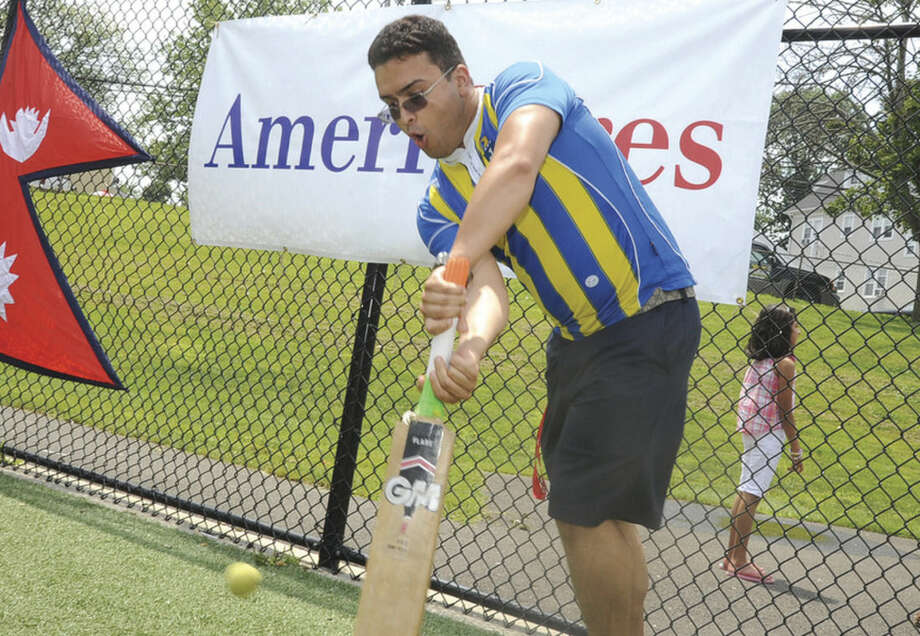 Hour photo/Matthew VinciStamford Cricket Club member Pukar Pudasaini participates in a game at Lione Park in Stamford, where the club raised over $13,000 for Americares for its recent work in Nepal.