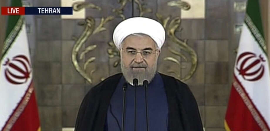 This image made from video broadcast on Press TV, Iran's English language state-run channel shows President Hassan Rouhani making a statement following announcement of the Iran nuclear deal, Tuesday, July 14, 2015 in Tehran. Rouhani says 'a new chapter' has begun in relations with the world. (Press TV via AP video)