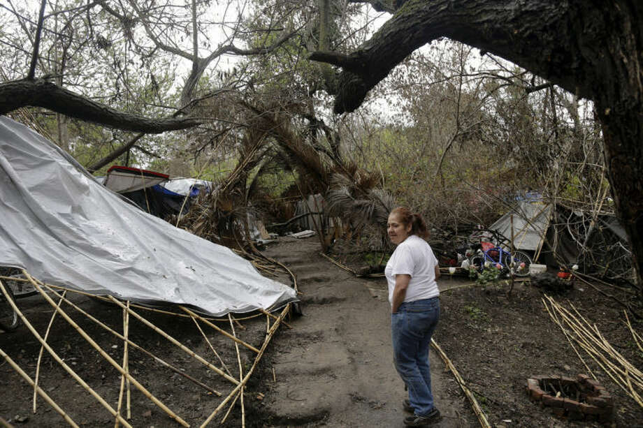 ADVANCE FOR USE SUNDAY, JULY 6, 2014, AND THEREAFTER- In this Feb. 28, 2014 photo, Maria Esther Salazar walks in the Jungle, a homeless encampment in San Jose, Calif. The Jungle and several hundred smaller encampments in the region are the consequence of urban sprawl, with large open spaces that are not parks, and thus without rangers. (AP Photo/Marcio Jose Sanchez)