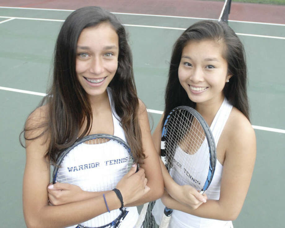 Hour photo/John NashWilton High's doubles tandem of Taylor Ingerman, left, and Kaitlyn Zheng helped lead Wilton to a state team championship. The two also won a State Open doubles title.