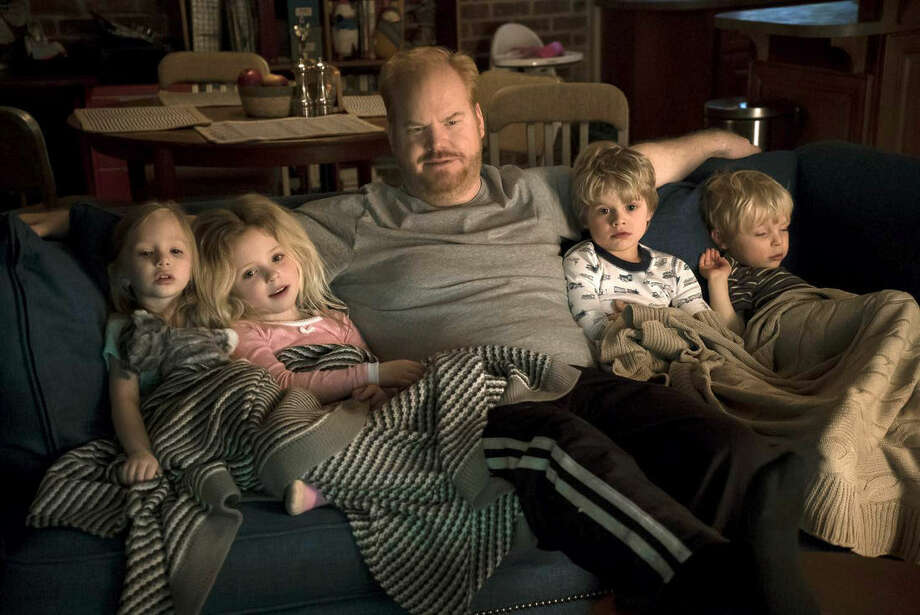 """This image released by TV Land shows Jim Gaffigan, center, in a scene from his new comedy series, """"The Jim Gaffigan Show,"""" premiering Wednesday, July 15, at 10 p.m. EDT on TV Land. (TV Land via AP)"""