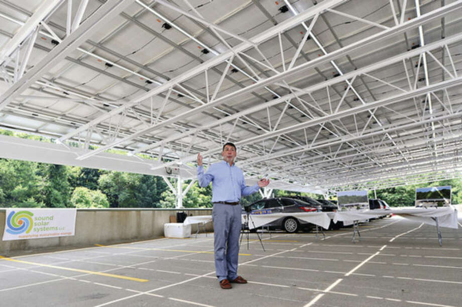 Hour photo / Erik Trautmann Sound Solar Systems principal, Tony Savino, announces the installation of a solar array at the 542 Westport Ave. plaza parking garage during a press conference Tuesday.