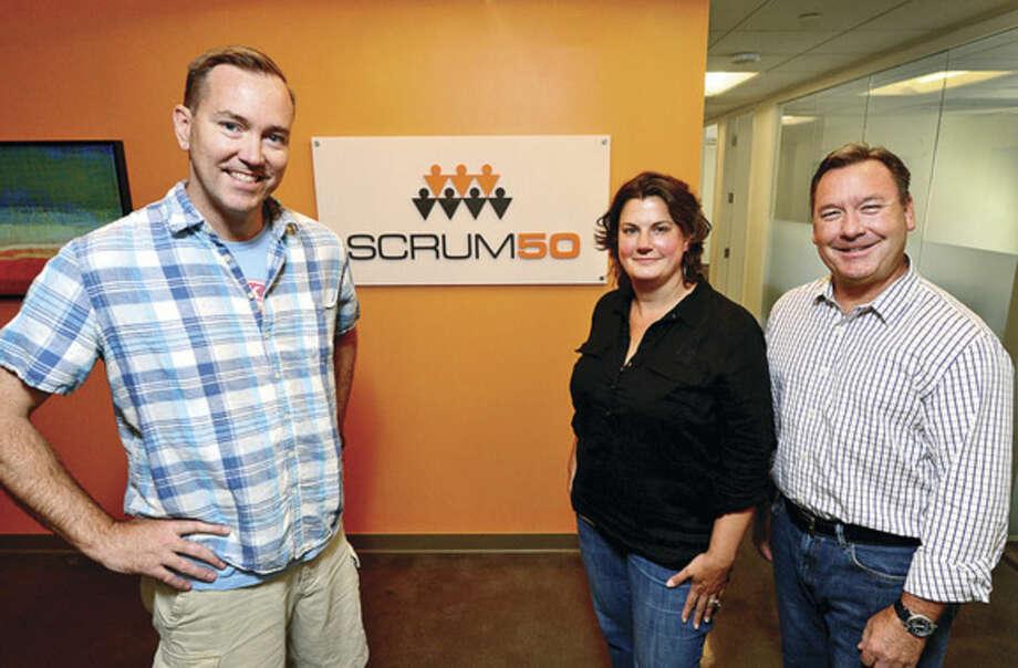 Hour photo / Erik TrautmannManaging partners of Norwalk media planning agency, Scrum50: Chris Parker, Jen Miller and Mike LeBeau.