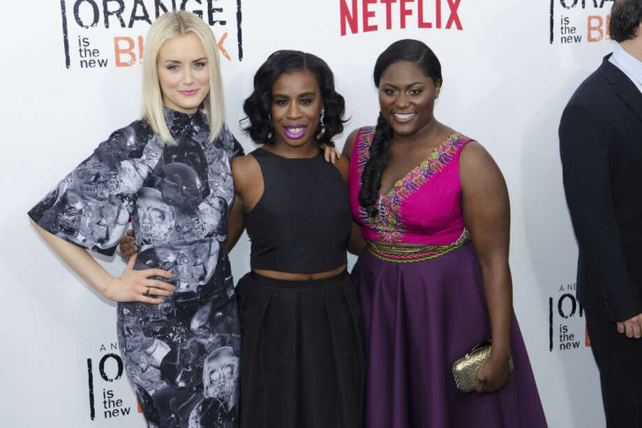 FILE - In this May 15, 2014, file photo, Taylor Schilling, from left, Uzo Aduba and Danielle Brooks attend Netflix's