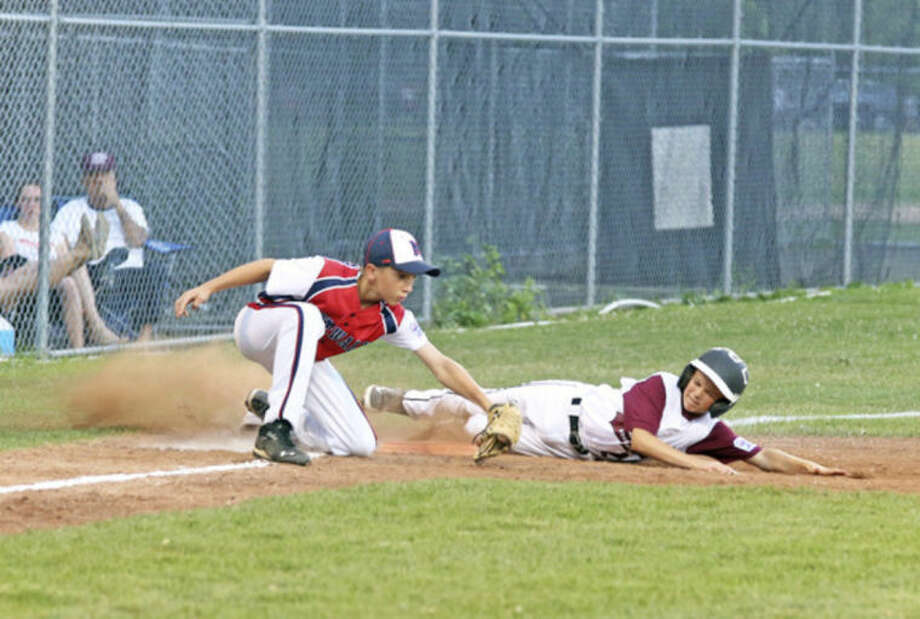 Hour photo/Danielle CallowayNorwalk's Jack Fitzpatrick lays down the tag at third during Monday night's District 1 Little League playoff game against Stamford National. Norwalk would win 11-4 in four innings.