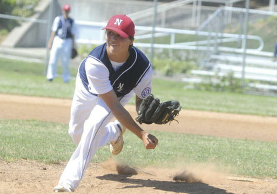 Hour photo/Matthew VinciNorwalk Babe Ruth All-Star starting pitcher Mike Gonzales fires a pitch to the plate during Sunday's District 2 15-year-old championship game in Norwalk.