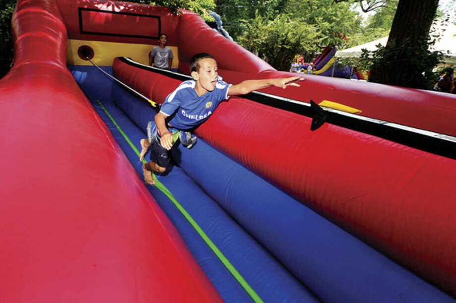 Hour photo / Erik Trautmann 10 year old Clive Cox tries the Moonwalker Bungee Run during the 45th annual Rowayton Civic Association River Ramble! at Pinkney Park Saturday.