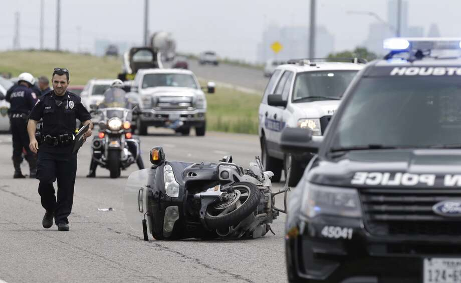 Police are shown at the scene along 288 near Airport Blvd. where a Metro motorcycle police officer was hit by a car Monday, June 13, 2016. Photo: Melissa Phillip/ Houston Chronicle
