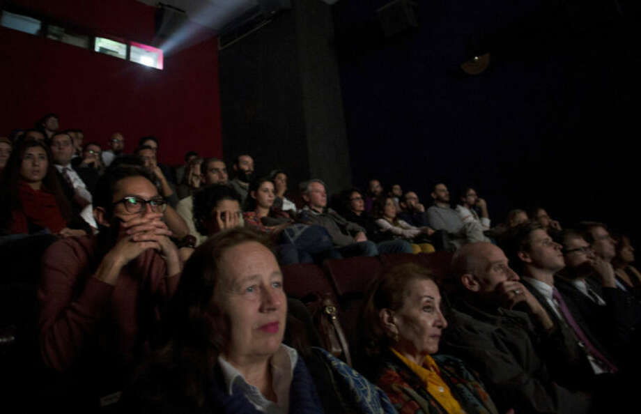 In this March 19, 2014 photo, Egyptians watch a movie in the Zawya cinema in downtown Cairo. It is a project to bring alternative art cinema to an audience that rarely sees it in Egypt where one of the world's oldest movie industries has fallen into decline. (AP Photo/Khalil Hamra)