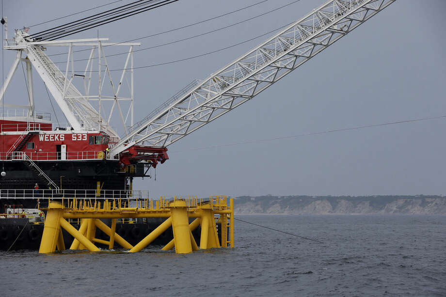 The first foundation jacket installed by Deepwater Wind in the nation's first offshore wind farm construction project is seen Monday, July 27, 2015, on the waters of the Atlantic Ocean off Block Island, R.I. Deepwater Wind will consist of five turbines producing a total of 30 megawatts of electricity. (AP Photo/Stephan Savoia)