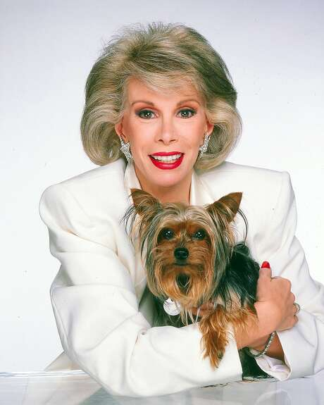 Comedian Joan Rivers with Spike in 1985 Photo: Harry Langdon, Getty Images
