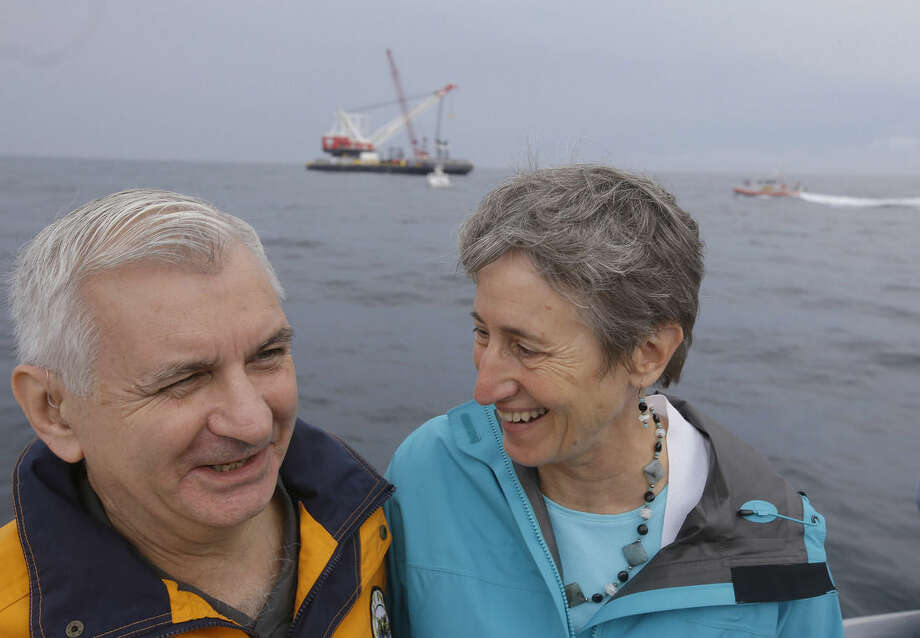 U.S. Secretary of the Interior Sally Jewell, right, and U.S. Senator Jack Reed, D-R.I., converse as they steam past a construction barge working on Deepwater Wind, the nation's first offshore wind farm, Monday, July 27, 2015, on the waters of the Atlantic Ocean off Block Island, R.I. Deepwater Wind will consist of five turbines producing a total of 30 megawatts of electricity. (AP Photo/Stephan Savoia)